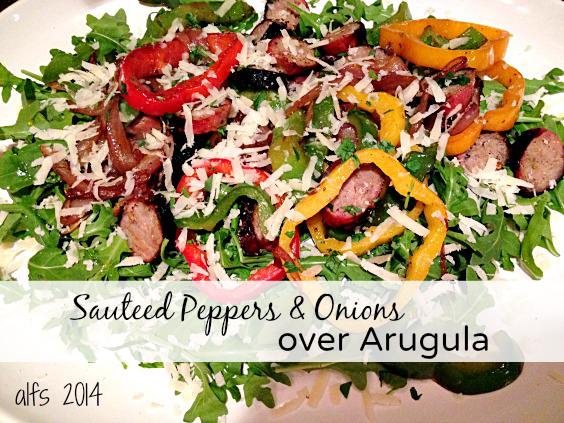 sauteed peppers and onions over arugula