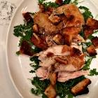 Roast chicken over arugula.