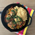 Crispy thighs with peppers and cous cous