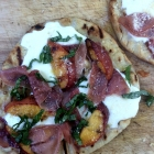 Grilled peach and prosciutto pizza.